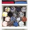 Loop - das flexible Schalregal - weiß im Fach eines Kleiderschranks mit Schals – corpus delicti design Hamburg – Wir machen Geschenke