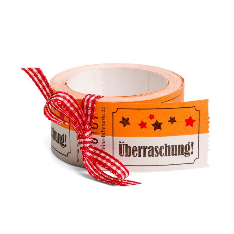 Wertmarke ÜBERRASCHUNG als Rolle auf dem Tisch – corpus delicti design Hamburg – Wir machen Geschenke
